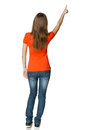 Back view of young casual female in full length pointing at blank copy space Royalty Free Stock Images