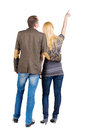 Back view of young couple pointing Stock Photos