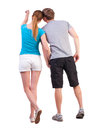 Back view of young couple pointing at wall woman and man rear view people collection backside view of person isolated over white Stock Photos