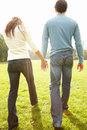 Back view of a young couple walking together Royalty Free Stock Photography