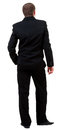 Back view of young guy in black suit  watching. Royalty Free Stock Photo