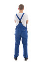 Back view of young handsome man in blue workwear isolated on whi white background Stock Images