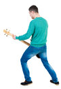 Back view of a young man with a guitar. Royalty Free Stock Photo