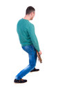 Back view of young man with a guitar. Royalty Free Stock Photo
