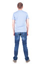 Back view of young man in t shirt and jeans looking standing guy rear people collection backside person Royalty Free Stock Photo