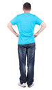 Back view of young men in  blue t-shirt and jeans. Royalty Free Stock Images