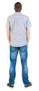 Back view of young men in  shirt and jeans. Royalty Free Stock Image