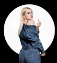 Back view of young woman in denim jaket and jeans show middle finger, fuck you off sign on white background. indecent Royalty Free Stock Photo