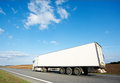 Back of white lorry trailer over blue sky Royalty Free Stock Photo