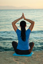 Back of woman doing yoga at sea Stock Images