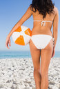 Back of womans perfect body holding beach ball Royalty Free Stock Photo