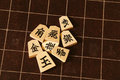 Backboard and pieces of shogi japanese board game Royalty Free Stock Images