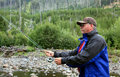 Backcountry flyfishing in yellowstone a flyfisherman casts a line the peaceful Royalty Free Stock Photos