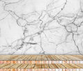Backdrop abstract marble wall and wood slabs arranged in perspective texture background.. Royalty Free Stock Photo
