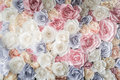 Backdrop of colorful paper roses background in a wedding reception with soft colors Royalty Free Stock Image