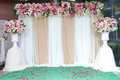 Backdrop flowers arrangement for wedding ceremony. Royalty Free Stock Photo