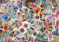 Backdrop of old U.S. postage stamps Royalty Free Stock Images