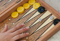 Backgammon game with hand throwing the dice Stock Photos