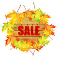 Background autumn sale billboard decorated with maple leaves with a message about the wooden billboard decorated with Royalty Free Stock Images