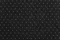Background of black color with round specks the abstract textured fabric and light are located in ranks on a surface on all area Royalty Free Stock Photos