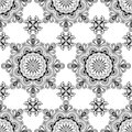 Background with black and white mehndi henna seamless lace buta decoration items on white background in Indian style. Royalty Free Stock Photo