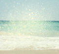 Background of blurred beach and sea waves with bokeh lights vintage filter Stock Photography