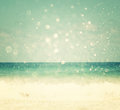 Background of blurred beach and sea waves with bokeh lights vintage filter Royalty Free Stock Photo