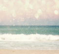 Background of blurred beach and sea waves with bokeh lights vintage filter Stock Photo