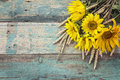 Background with a bouquet of yellow sunflowers and wheat ears on Royalty Free Stock Photo