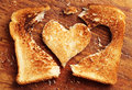 Background with bread toast in shape of hearts Stock Image