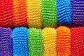 Background from bright multicolored soft ribbons close-up