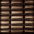 Background brown leather upholstery Stock Images