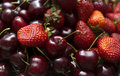Background of cherry and strawberry Stock Images