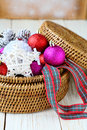 Background with christmas decorations in a round wicker basket decor Royalty Free Stock Photos