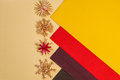Background for christmas greeting card holiday straw decoration red and yellow color textured paper composition of snow flakes Stock Images