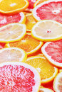 Background with citrus fruit of fresh fruit slices focus in the middle the frame shallow depth field Stock Photos
