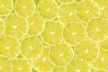 Background with citrus fruit of lime slices abstract yellow close up pattern Stock Photography