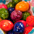 Background of colorful marbled easter eggs traditional painted and decorated in the colors the rainbow displayed in a container Royalty Free Stock Photography