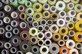 Background of colorful spools of thread top view Royalty Free Stock Photo