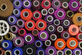 Background of colorful spools of thread top view Stock Photography