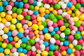 Background of colorful sugar balls the image depicts a cheerful Stock Photo