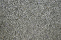 Background of concrete dark gray wall and multi-colored gravel w