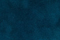 Background of dark blue suede fabric closeup. Velvet matt texture of navy blue nubuck textile Royalty Free Stock Photo