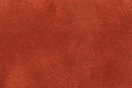 Background of dark orange suede fabric closeup. Velvet matt texture of ginger nubuck textile Royalty Free Stock Photo