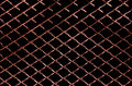 Background of dark red metal net texture Royalty Free Stock Photo