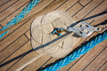 Background deck sailing ship thick rope braided in celtic knot work shape on a wooden floor Stock Photography