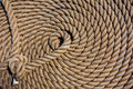 Background deck sailing ship thick rope in spiral or ring shape on a wooden floor Royalty Free Stock Images