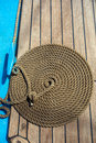 Background deck sailing ship thick rope in spiral or ring shape on a wooden floor Royalty Free Stock Image