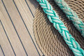 Background deck sailing ship thick rope in spiral or ring shape on a wooden floor Stock Photo