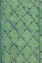Background of decorated door with wrought iron green Royalty Free Stock Photography